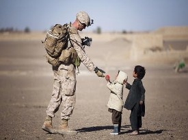 A Soldier passing out candy